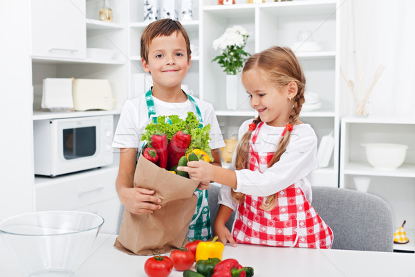 Kids unpacking the groceries Stock photo © ilona75
