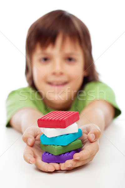 Colorful modelling clay blocks in boy hands Stock photo © ilona75