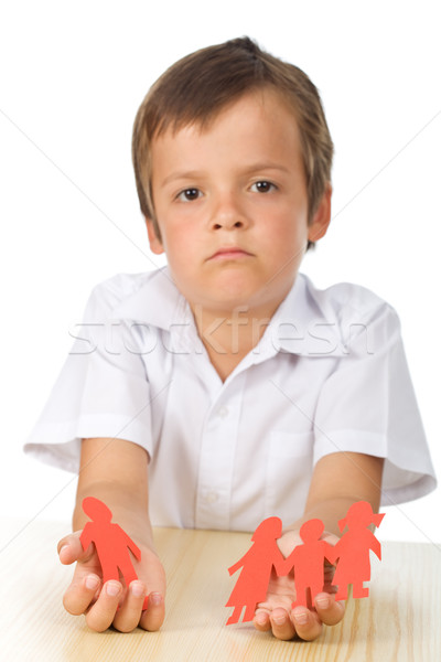 Sad kid with paper people in hands - divorce concept Stock photo © ilona75
