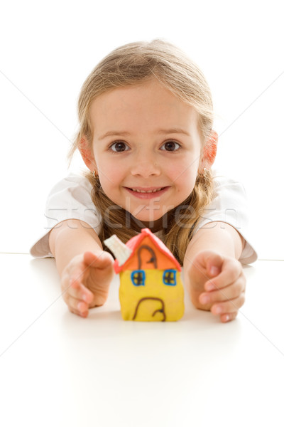 Ecstatic little girl with her clay house Stock photo © ilona75