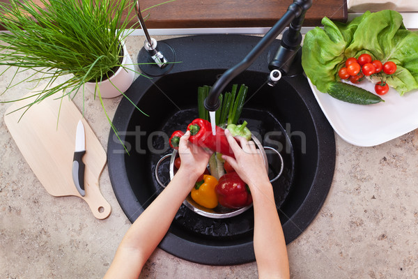 Washing vegetables to make a fresh salad - child hands scrubbing Stock photo © ilona75