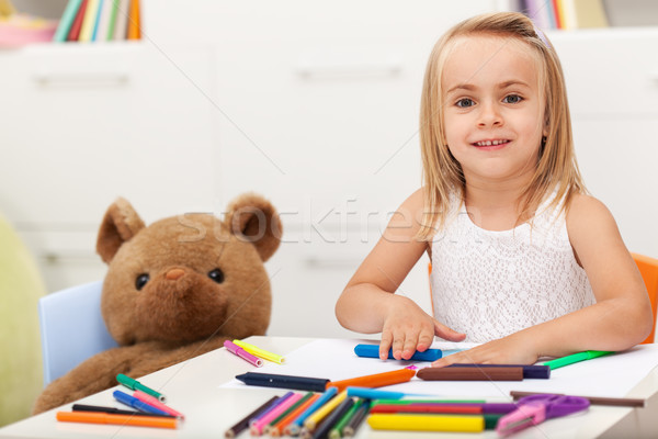 Little girl drawing with her toy bear keeping company Stock photo © ilona75