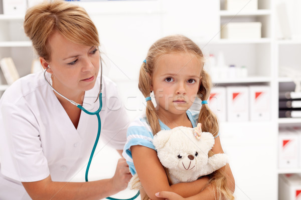 Stock photo: Little girl at the doctor