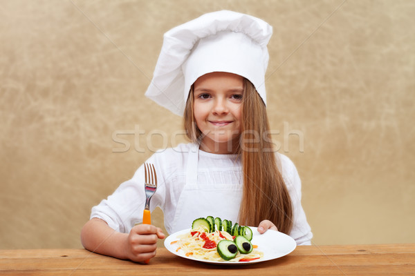 Happy child with chef hat and decorated pasta dish Stock photo © ilona75