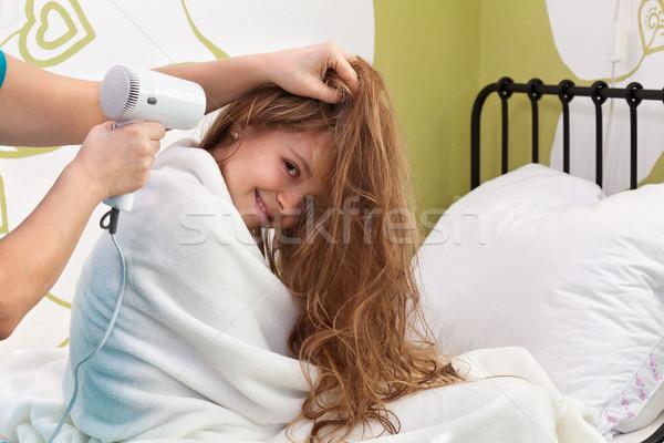 Genç kız saç kurutulmuş banyo oturma Stok fotoğraf © ilona75