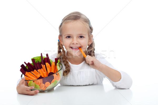 Little girl munching on a carrot stick Stock photo © ilona75