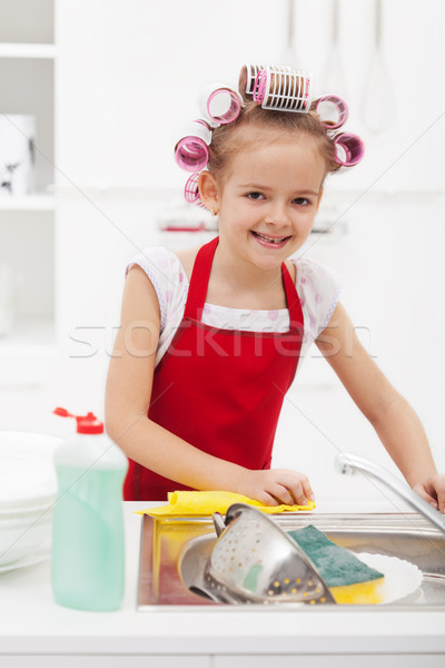 Little girl housekeeping - doing the dishes Stock photo © ilona75