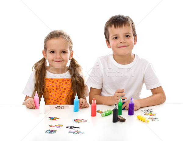 Kids coloring with lots of small painting bottles Stock photo © ilona75
