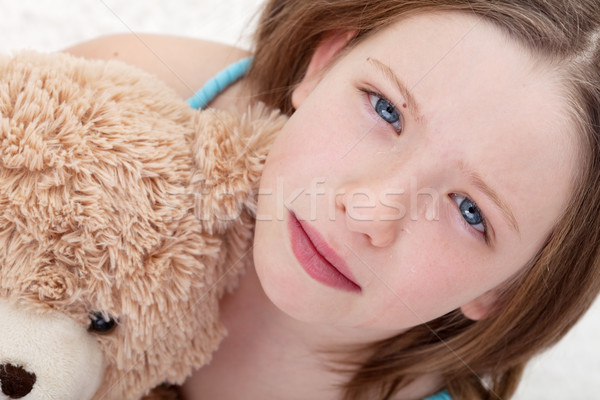 Sad girl holding teddy bear and crying Stock photo © ilona75