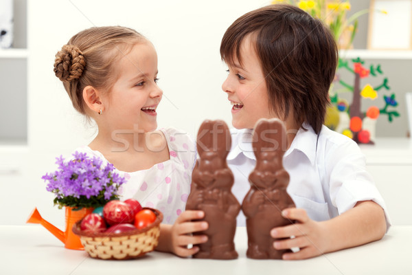 Happy kids at easter time with large chocolate bunnies Stock photo © ilona75