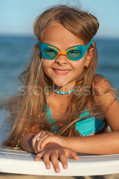 Little girl natação óculos de proteção banhos de sol mar costa Foto stock © ilona75