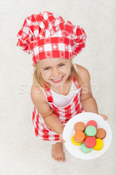 Extremely happy little chef with a plate of colorful cookies - l Stock photo © ilona75