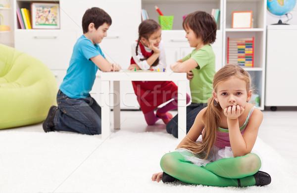Smutne dziewczyna uczucie grupy gry dzieci Zdjęcia stock © ilona75