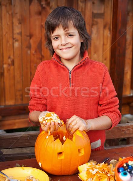 Closeup of boy carving Halloween jack-o-lantern Stock photo © ilona75