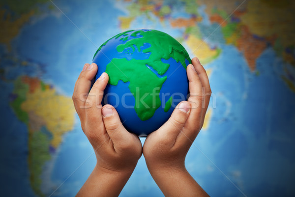 Ecology concept with earth in child hands Stock photo © ilona75