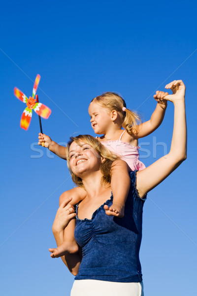 Little girl and woman with a pinwheel toy outdoors Stock photo © ilona75