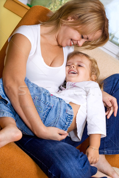Stock photo: Woman and little girl cuddling