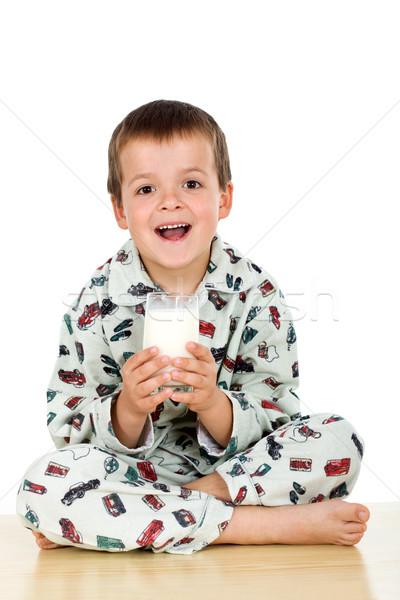 Happy kid with his bedtime glass of milk Stock photo © ilona75