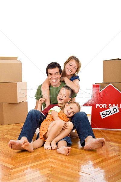 Stock photo: Happy couple with two kids in their new home