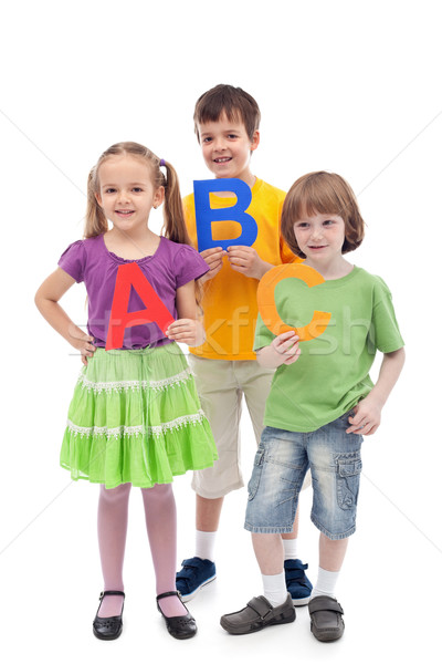 Back to school - kids holding large abc letters Stock photo © ilona75