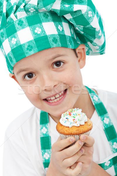 Gyermek szakács sapka tart muffin boldog mosoly Stock fotó © ilona75