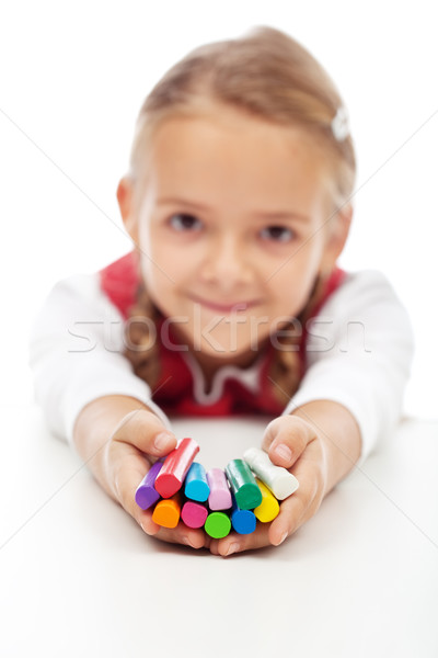 Happy little girl holding colorful modelling clay bars Stock photo © ilona75