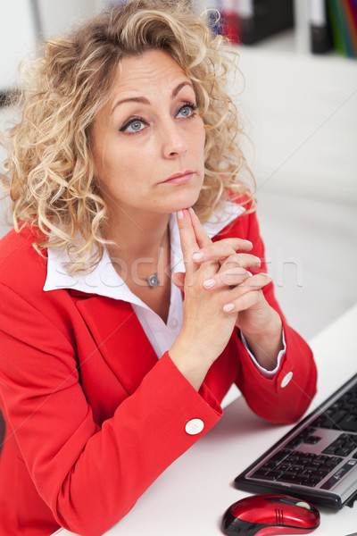 Business woman thinking at her desk Stock photo © ilona75