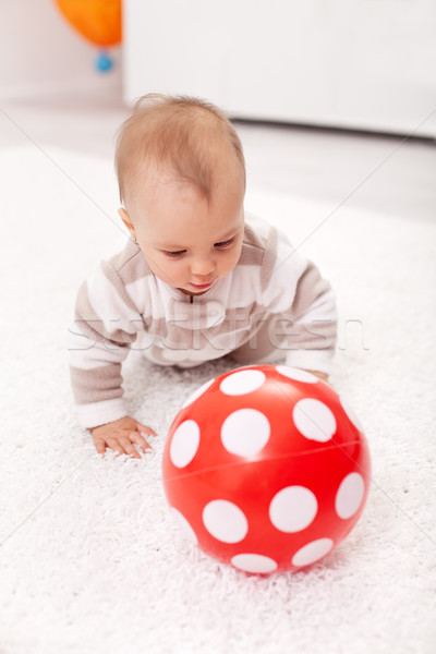 Baby girl chasing a red ball Stock photo © ilona75