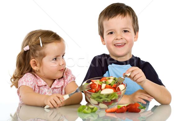 Enfants manger salade de fruits heureux saine alimentaire Photo stock © ilona75