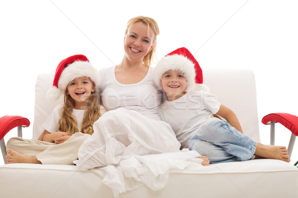 Woman with kids sitting on a sofa at christmas time Stock photo © ilona75