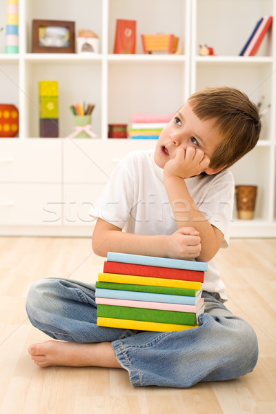 Bored kid with lots of school books Stock photo © ilona75