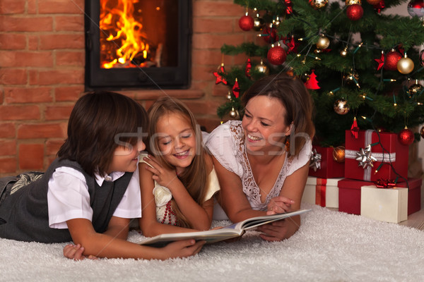 Family reading a story at Christmas time Stock photo © ilona75