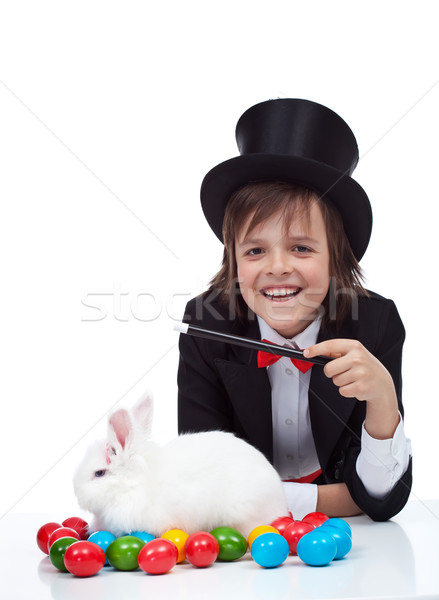 The magic of easter - happy magician boy and grumpy rabbit Stock photo © ilona75