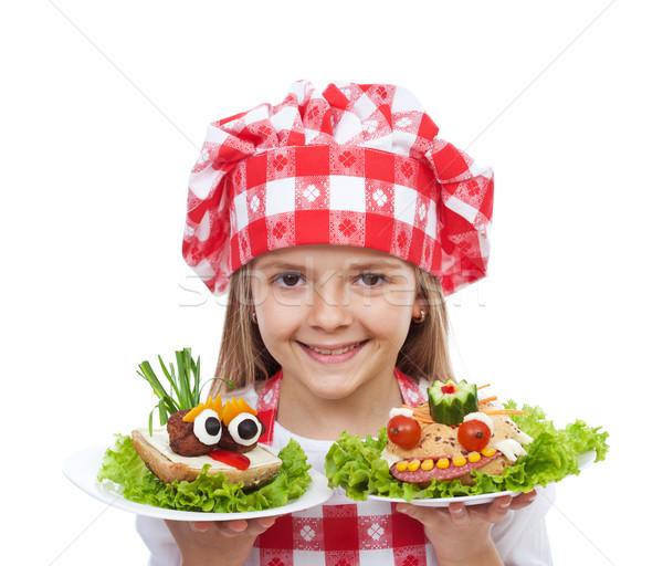 Happy little girl chef with creative sandwiches Stock photo © ilona75