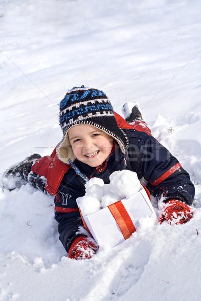 Vidám fiú hó doboz fektet arc boldog Stock fotó © ilona75