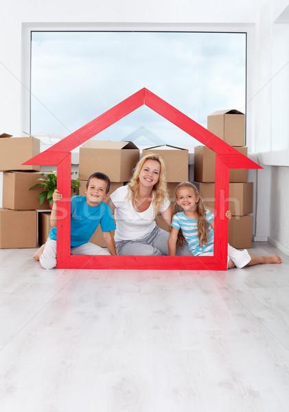 Happy family in their new home Stock photo © ilona75