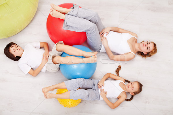 Family relaxing after gymnastic exercise Stock photo © ilona75