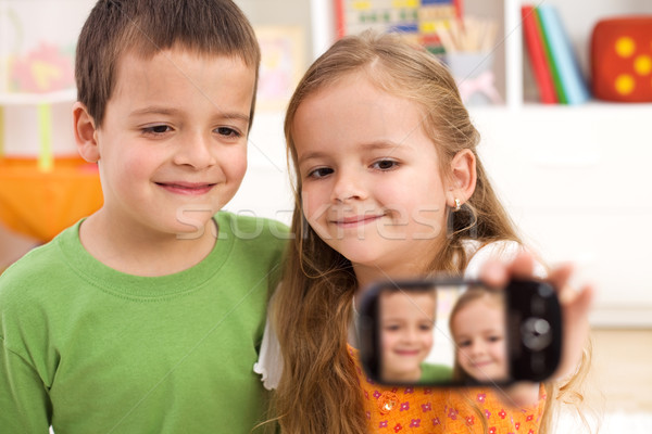 Say cheese - kids taking a photo of themselves Stock photo © ilona75