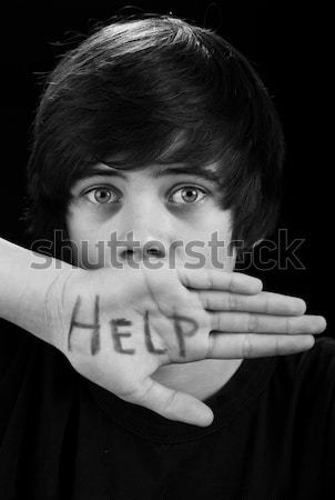 Scared teenager boy needs help Stock photo © ilona75