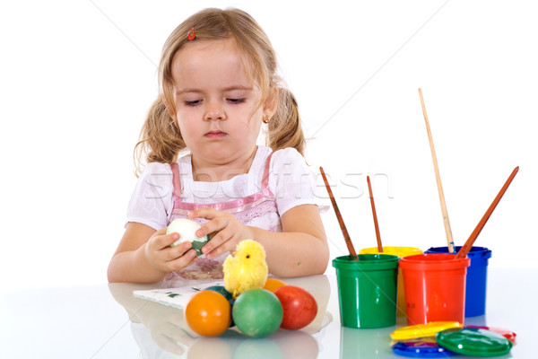 Little girl painting the easter eggs Stock photo © ilona75
