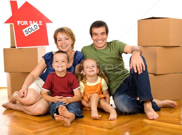 Boldog család karton dobozok mozog új otthon padló Stock fotó © ilona75