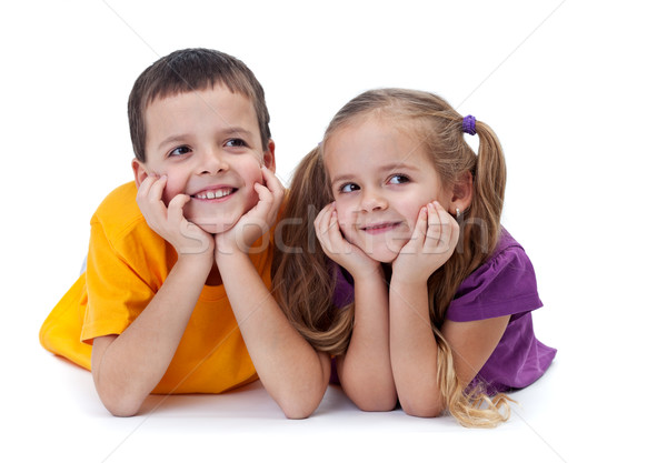 Mosolyog testvérek fekszik néz oldal lány Stock fotó © ilona75
