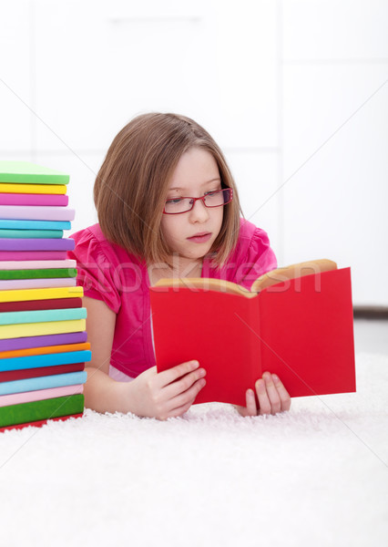 Young girl absorbed by reading Stock photo © ilona75