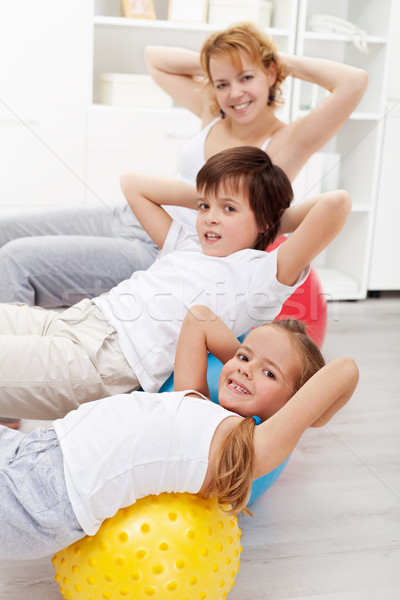 Stock photo: Kids with their mother doing gymnastic exercises