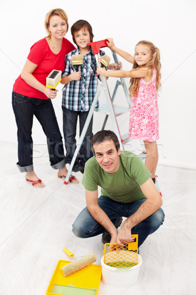 Family repainting their home together Stock photo © ilona75