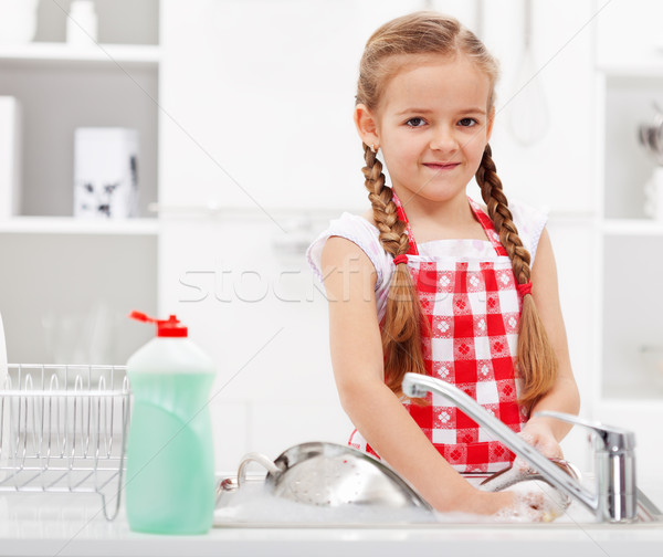 Little girl washing dishes in the kitchen Stock photo © ilona75