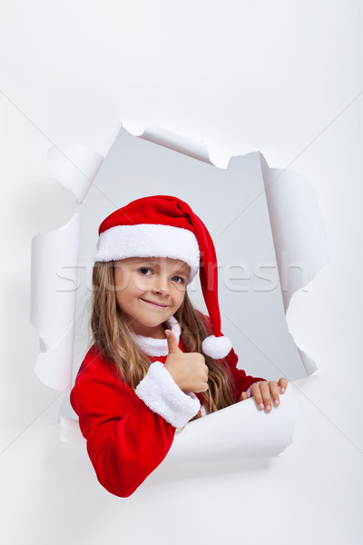 Little girl in Santa Claus outfit giving thums up sign Stock photo © ilona75