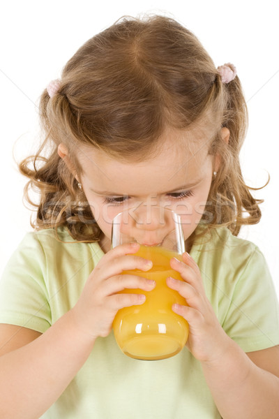 Little girl drinking fruit juice Stock photo © ilona75