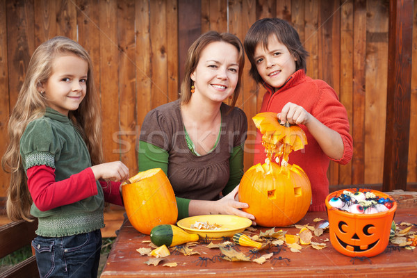Kids carving jack-o-lanterns for Halloween Stock photo © ilona75