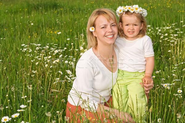 Stock photo: Mother and daughter on the flower field